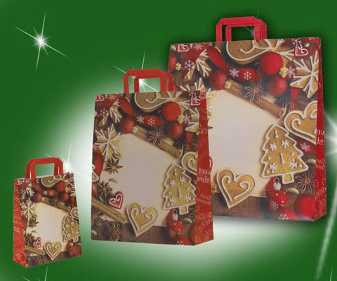Weihnachtstaschen in verschiedenen größen mit Lebkuchen bedruckt als Griffe wurden rote flachhenkel eingesetzt